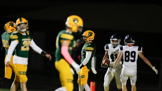 Bay Port's Isaiah Gash (41) scores a touchdown and celebrates with Sam Plumb, 89, to make the score 48-0 during their football game on Friday, Oct. 4, 2019, at Ashwaubenon High School in Ashwaubenon, Wis. Bay Port defeated Ashwaubenon 55-0.