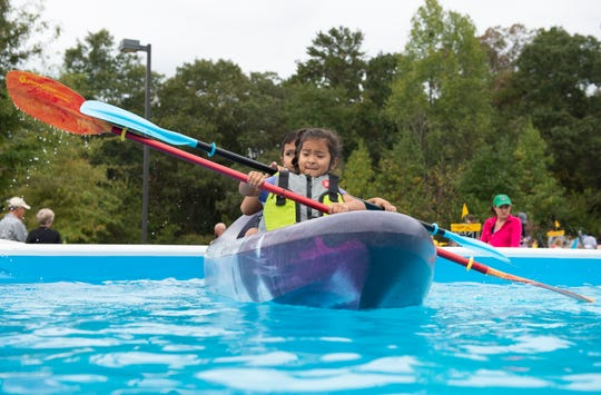 File photo from October, of Michelle Cardenas, 5, and her cousin Mario Brito, 5, of Berea. With an abundance of lakes and rivers within short drives, water activities like boating and kayaking are a fun, safe way to exercise outdoors.