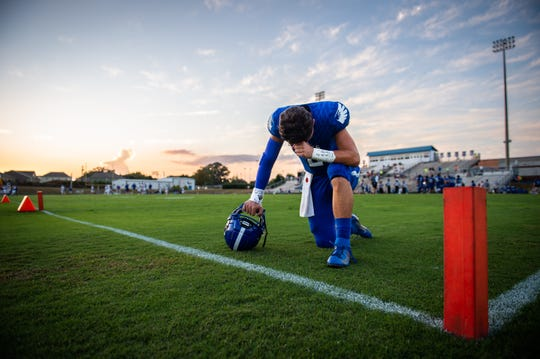 Eastside's Marshall Skoloff (6) prays in the corner of the endzone before their game against Travelers Rest Friday, October 4, 2019. Eastside won 45-34.