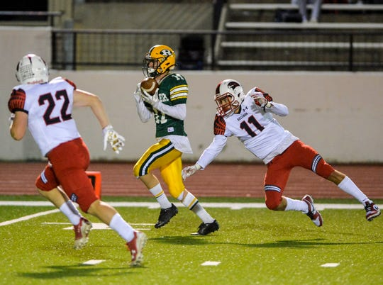 CMR's Bryce Nelson makes a catch as Bozeman's Hudson Willett defends during Friday's football game at Memorial Stadium.