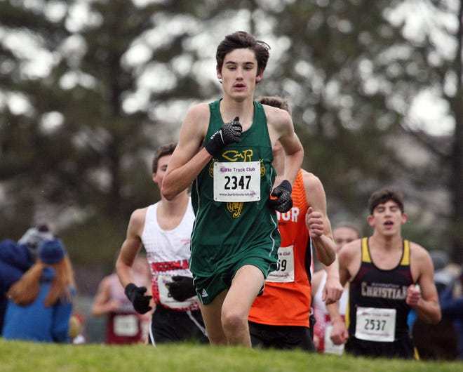 Great Falls CMR's Connor O'Hara crosses a hill during the Butte Invitational Cross Country Carnival at Stodden Park in Butte. O'Hara finished second in 16:00.6.