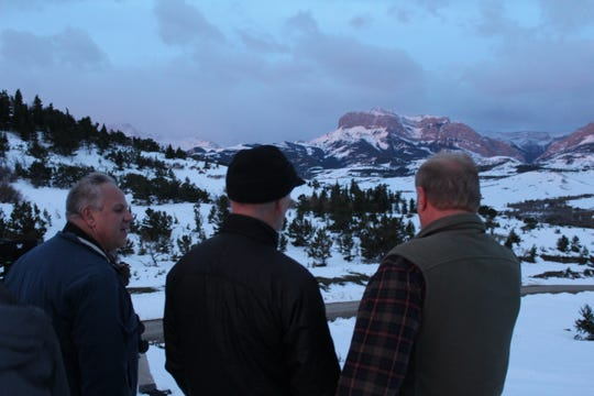 U.S. Interior Secretary David Bernhardt (left), Montana Representative Greg Gianforte (middle) and Boone and Crocket Club Chief of Staff Tony Schoonen search for grizzly bears on the Rocky Mountain Front