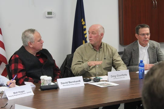 U.S. Interior Secretary David Bernhardt (left) and Montana Representative Greg Gianforte (middle) discuss grizzly bear management during a roundtable discussion in Choteau with local residents and state officials. Montana USDA Wildlife Services Director John Steuber is seated right