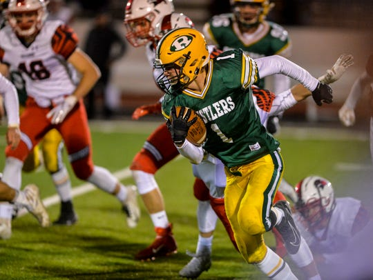 CMR's Tucker Harrison runs with the football on a kickoff return during Friday's game against Bozeman.