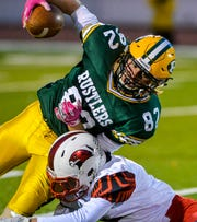 CMR's Griffin Held runs with the football during Friday's game against Bozeman.