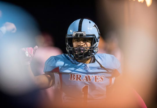 Union County's Ben Shreve (1) gets a fist bump after a touchdown as the Union County Braves take on the Webster County Trojans at Baker Field in Morganfield, Ky., Friday evening, Oct. 4, 2019.