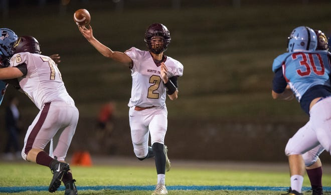 Webster County's Mason Wilson (2) releases a pass as the Webster County Trojans take on the Union County Braves at Baker Field in Morganfield, Ky., Friday evening, Oct. 4, 2019.