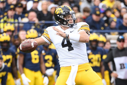 Iowa quarterback Nate Stanley (4) was under pressure all day against Michigan.