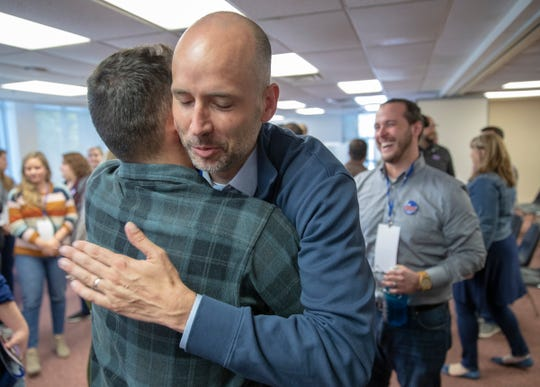 Ryan Mears, newly elected Marion County Prosecutor, gets a hug from a well-wisher in Indianapolis on Saturday, Oct. 5, 2019. Mears beat Mayor Hogsett's pick, Tim Moriarty.