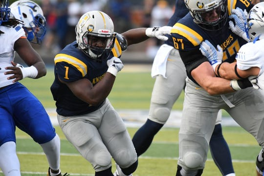 Marian running back Charles Salary finds some room versus St. Francis on Saturday.