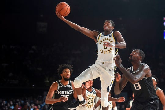 Indiana Pacers player Edmond Sumner (C) shoots the ball during the second pre-season NBA basketball game between Sacramento Kings and Indiana Pacers at the NSCI Dome in Mumbai on October 5, 2019.