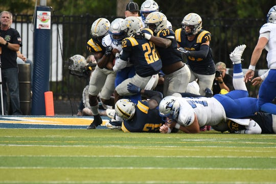 The Marian defense holds firm against St. Francis on Saturday.