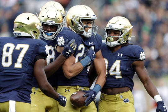 Notre Dame tight end Tommy Tremble (24) celebrates after scoring a touchdown during the first half of an NCAA college football game against Bowling Green, Saturday, Oct. 5, 2019, in South Bend, Ind. (AP Photo/Darron Cummings)