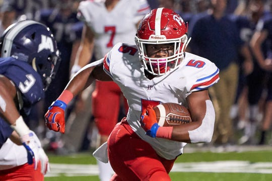 Jackson Prep running back Matt Jones (5) runs the ball against Jackson Academy October 4th 2019 in Jackson, Mississippi.(Bob Smith/Special to the Clarion Ledger)