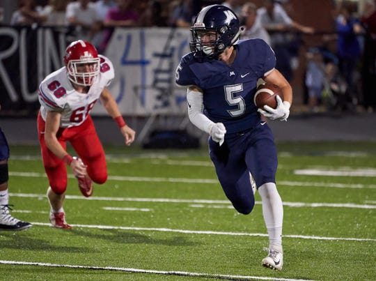 Jackson Academy's William Janous (5) runs the reverse for a big gain against Jackson Prep October 4th 2019 in Jackson, Mississippi.(Bob Smith/Special to the Clarion Ledger)