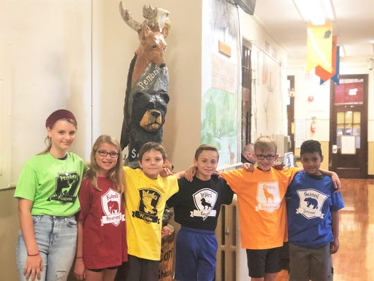 "House leaders proudly show off the new totem pole at Corryton Elementary School on Oct. 3: Addy Melton (Pemberi); Tayler Blake (Kuanda); Benton Foster (Boosara); Cameron Bates (Jelani); Colton Howard (Ohana) and Isaac Slade (Somni). ""Students bring their cameras and ask us to take their photo with the totem pole,"" said Aaron Maddox, Corryton Elementary School principal."