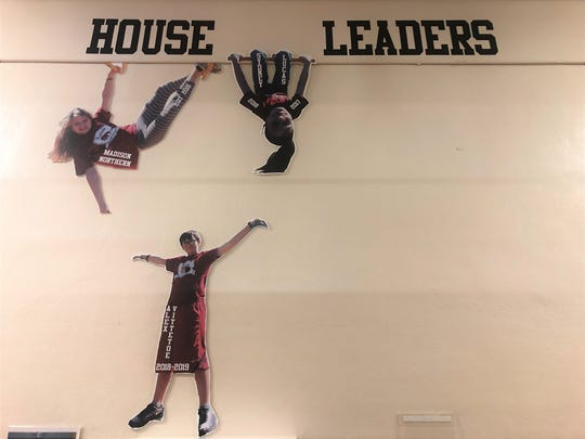 Pictures of previous Kuanda house leaders on the walls at Corryton Elementary School. House leaders give a speech as to why they would be a good leader and they vote. They head up food drives and service projects.