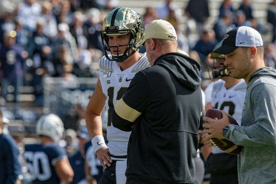 Oct 5, 2019; University Park, PA, USA; Purdue Boilermakers quarterback Jack Plummer (13) talks with head coach Jeff Brohm (right) before the game against the Penn State Nittany Lions at Beaver Stadium. Mandatory Credit: John Jones-USA TODAY Sports