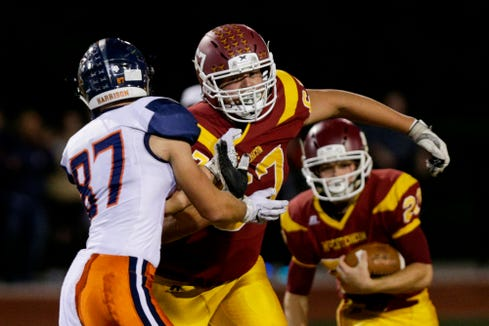 McCutcheon offensive lineman Luke Morris (67) is blocked by Harrison defensive end Jacob Cain (87) during the second quarter of an IHSAA football game, Friday, Oct. 4, 2019 at McCutcheon High School in Lafayette. Harrison won, 42-14.