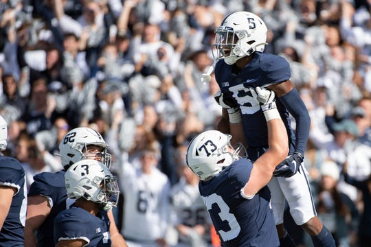 Penn State wide receiver Jahan Dotson (5) is lifted by offensive lineman Mike Miranda (73) after he scored on a 72-yard touchdown pass in the first quarter of an NCAA college football game against Purdue in State College, Pa., on Saturday, Oct. 5, 2019. (AP Photo/Barry Reeger)