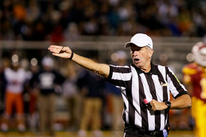 A referee makes a call during the third quarter of an IHSAA football game, Friday, Oct. 4, 2019 at McCutcheon High School in Lafayette. Harrison won, 42-14.