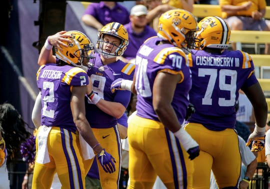 Oct 5, 2019; Baton Rouge, LA, USA; LSU Tigers quarterback Joe Burrow (9) celebrates with wide receiver Justin Jefferson (2) after a touchdown against the Utah State Aggies during the second half at Tiger Stadium. Mandatory Credit: Derick E. Hingle-USA TODAY Sports