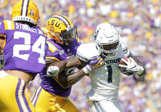 Oct 5, 2019; Baton Rouge, LA, USA; LSU Tigers linebacker Patrick Queen (8) tackles Utah State Aggies running back Gerold Bright (1) during the first quarter at Tiger Stadium. Mandatory Credit: Derick E. Hingle-USA TODAY Sports