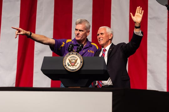 U.S. Sen. Billy Cassidy (left) and Vice President Mike Pence (right) greet the crowd at a rally held by the LAGOP in Kenner Saturday, Oct. 5, 2019.