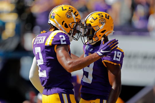 LSU wide receiver Derrick Dillon (19) celebrates his touchdown reception with wide receiver Justin Jefferson (2) in the first half of an NCAA college football game against Utah State in Baton Rouge, La., Saturday, Oct. 5, 2019. (AP Photo/Gerald Herbert)