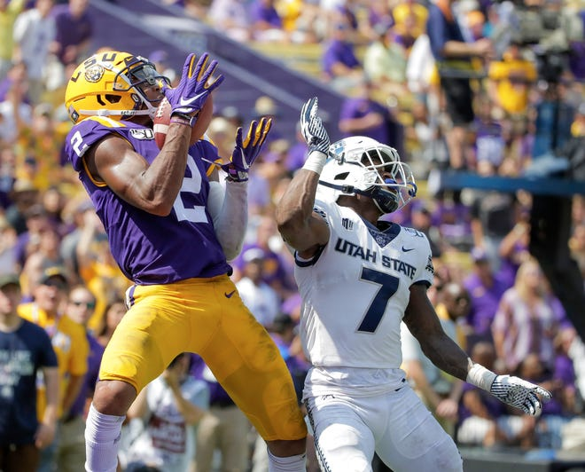 Oct 5, 2019; Baton Rouge, LA, USA; LSU Tigers wide receiver Justin Jefferson (2) catches a touchdown against Utah State Aggies cornerback DJ Williams (7) during the second half at Tiger Stadium. Mandatory Credit: Derick E. Hingle-USA TODAY Sports