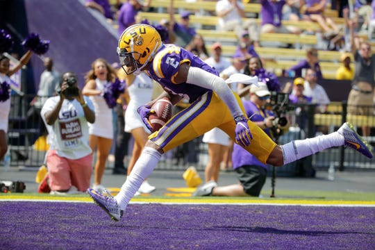Oct 5, 2019; Baton Rouge, LA, USA; LSU Tigers wide receiver Justin Jefferson (2) catches a touchdown against Utah State Aggies cornerback DJ Williams (not pictured) during the second half at Tiger Stadium. Mandatory Credit: Derick E. Hingle-USA TODAY Sports