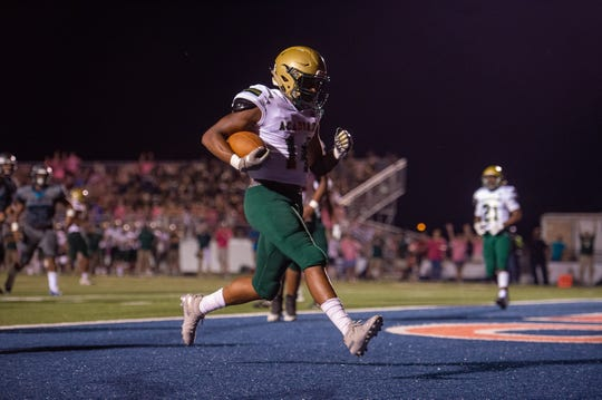 Acadiana High's Tyvin Zeno scores a touchdown as the Southside Sharks take on The Acadiana High Wreckin' Rams Friday, Oct. 4, 2019.