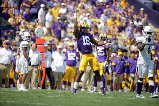 Oct 5, 2019; Baton Rouge, LA, USA; LSU Tigers linebacker K'Lavon Chaisson (18) reacts after a play against the Utah State Aggies during the first half at Tiger Stadium. Mandatory Credit: Derick E. Hingle-USA TODAY Sports