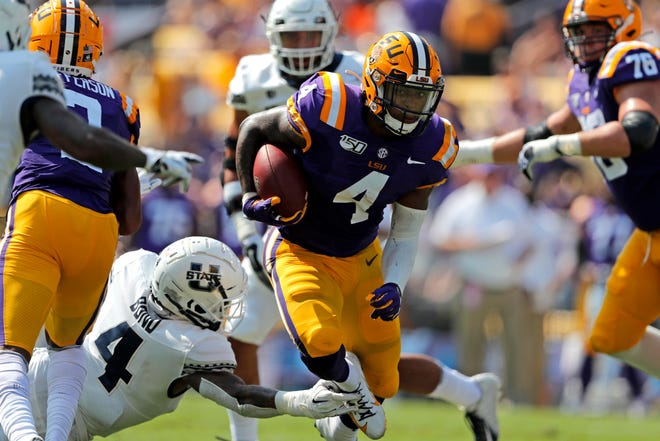 LSU running back John Emery Jr. (4) carries against Utah State safety Shaq Bond (4) in the first half of an NCAA college football game in Baton Rouge, La., Saturday, Oct. 5, 2019. (AP Photo/Gerald Herbert)