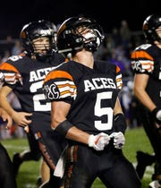 Amanda-Clearcreek's Jayse Miller celebrates after the Aces scored a touchdown last week against Bloom-Carroll. The Aces enhanced their chances of qualifying for the playoffs with a 21-14 win over the Bulldogs.