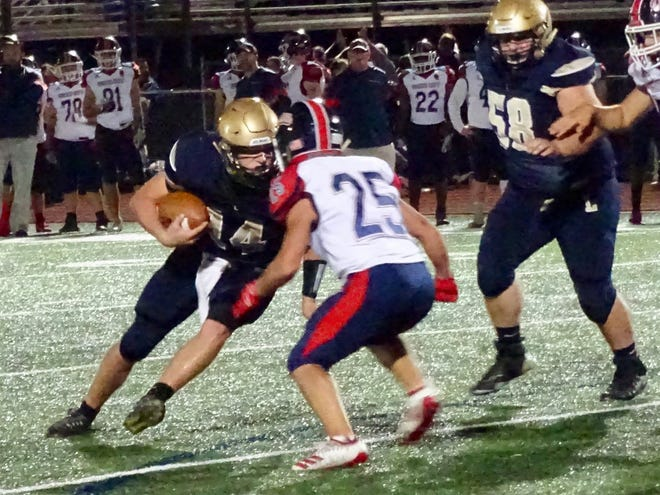 Lancaster senior quarterback Curtis Young runs the ball against Grove City. He rushed for 135 yards and two touchdowns to help lead the Golden Gales to a 34-12 victory.