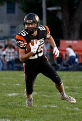 Amanda-Clearcreek senior running back Jesse Connell looks for running room during a game against Bloom-Carroll earlier this season. The Aces will be making their second consecutive playoff appearance on Saturday.