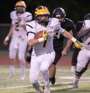 Hartland's Colby Spisz carries the ball in a 35-13 loss to Plymouth on Friday, Oct. 4, 2019.