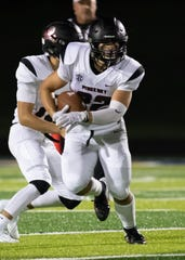 Pinckney's Sal Patierno ran 19 times for 147 yards and three touchdowns in a 49-0 victory over Adrian.