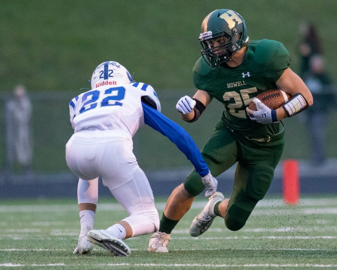 Howell running back Jonah Schrock, who ran for five touchdowns, eludes Salem's Ty Wagner on Friday Oct. 4, 2019.