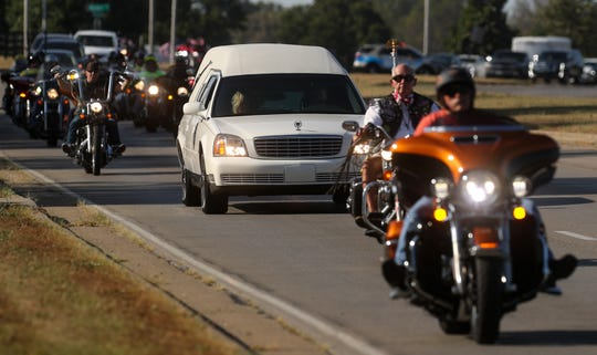 Members of the Patriot Guard motorcycle group escort the casket of Machinist Mate First Class Ulis Steely home to Corbin, Kentucky.  Steely was killed in the bombing of Pearl Harbor.  He was a sailor on the U.S.S. Oklahoma when he was killed.  