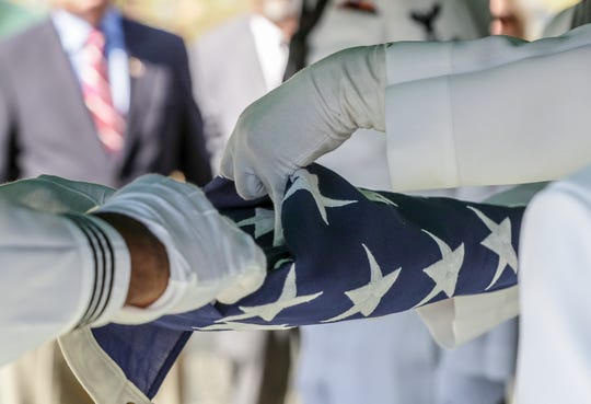 The flag that draped over the casket of Machinist Mate First Class Ulis Steely's casket is folded before begin presented to the family at Corinth Cemetery.