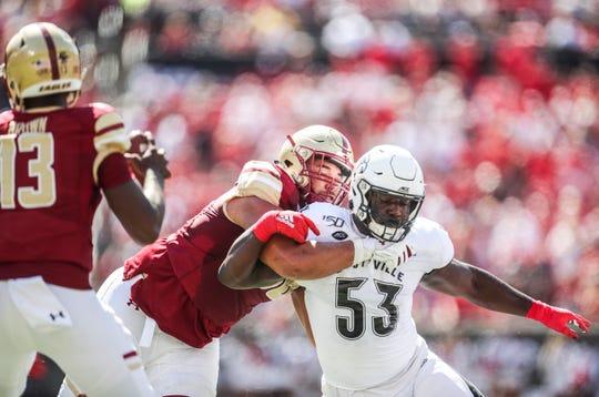 Louisville's Amonte Caban pressures Boston College quarterback Anthony Brown Saturday afternoon at Cardinal Stadium. Oct. 5, 2019
