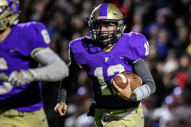 Fowlerville quarterback Kyle Lutz leads an offense that has had 360 rushes and only 38 passes this season.
