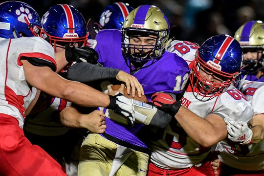 Quarterback Kyle Lutz (12) and his Fowlerville football teammates will look to bounce back from their first loss Friday against St. Johns.