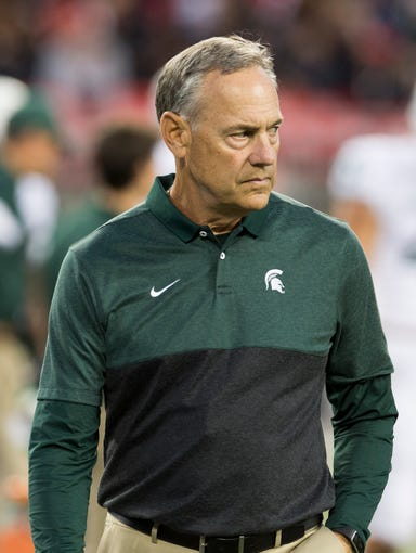 Oct 5, 2019; Columbus, OH, USA; Michigan State Spartans head coach Mark Dantonio watches his team warm up before the game against the Ohio State Buckeyes at Ohio Stadium. Mandatory Credit: Greg Bartram-US