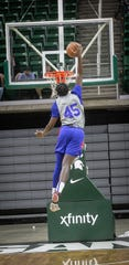 Pistons forward Sekou Doumbouya dunks in competition with teammates at Detroit Pistons scrimmage Saturday, Oct. 5, 2019, at Breslin Center in East Lansing.