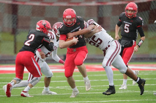 Manitowoc Lincoln's Brett Prange (24) carries the ball against De Pere Saturday in Manitowoc.