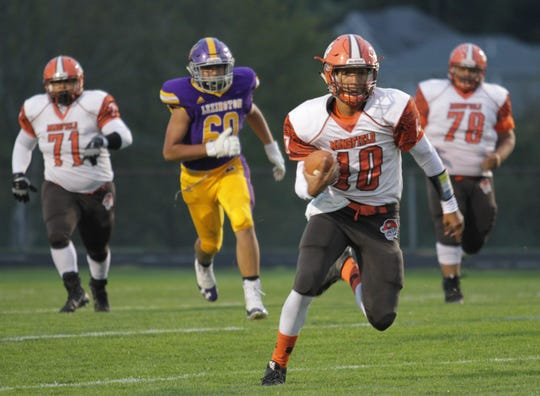Mansfield Senior quarterback Cameron Todd accounted for two touchdowns and 208 yards total offense in Friday's Ohio Cardinal Conference win over Lexington