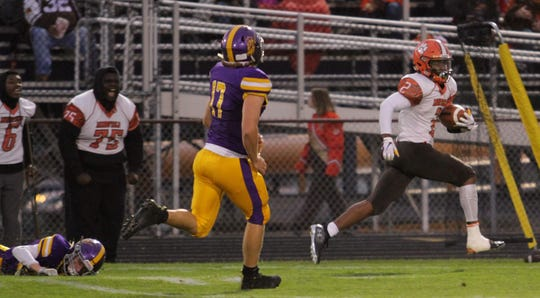 Mansfield Senior's Cyrus Ellerbe races past the Lexington defense on an 85-yard touchdown catch to open the scoring Friday night.
